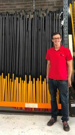 An image of Reach and Rescue's Production Manager with the telescopic poles
