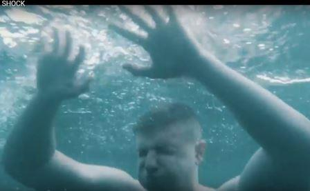 An image displaying a man suffering from cold water shock
