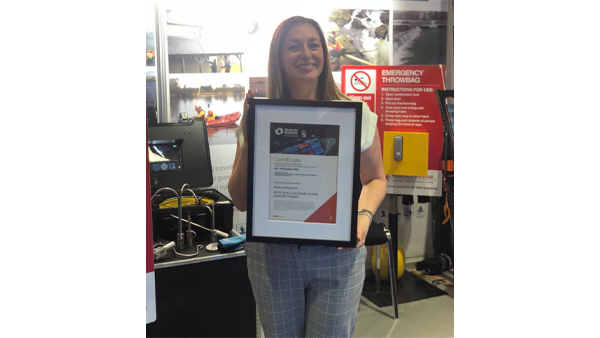 An image of Reach and Rescue's Director Jo Taylor holding an award for the best shell scheme at Seatrade Maritime Middle East 2018 in Dubai