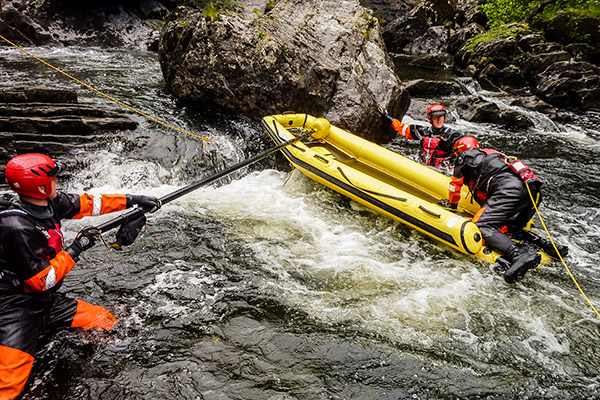 Search and Rescue Team Deploy Reach and Rescue Pole to Steady Raft in Swift Water