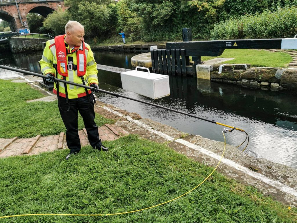 Merseyside Fire and Rescue Service working with the Reach and Rescue Body Finder in a canal lock