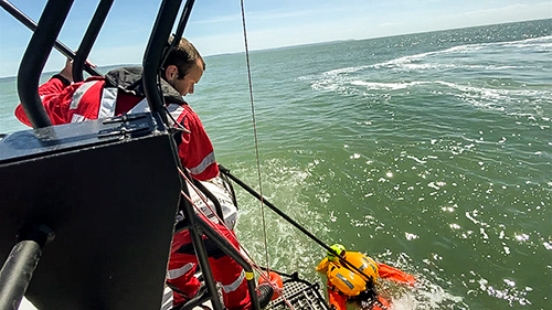 Rescue Pole Being Used in Port to Recover Man Overboard
