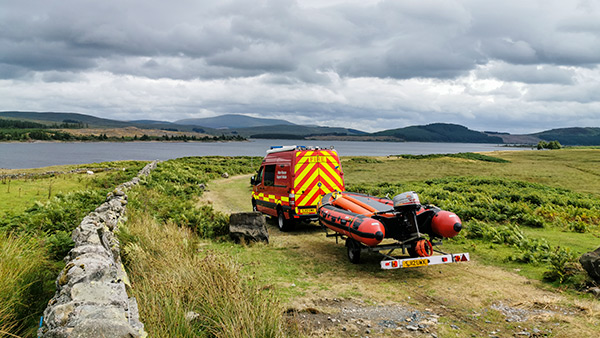 Loch Doon Emergency Service Vehicle with Rescue Boat Driving Down Slipway